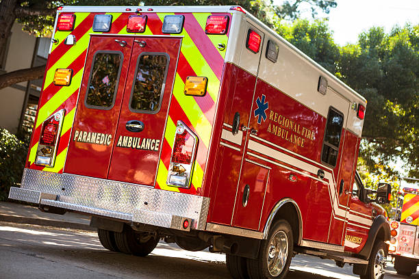 ambulance on the street in an emergency - emergency response stock pictures, royalty-free photos & images