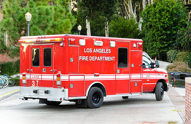 """LAFD Ambulance on UCLA Campus Los Angeles, California, USA - December 7, 2011: Los Angeles Fire Department ambulance parked on the \""""University of California, Los Angeles\"""" campus during an emergency call. ucla medical center stock pictures, royalty-free photos & images"""
