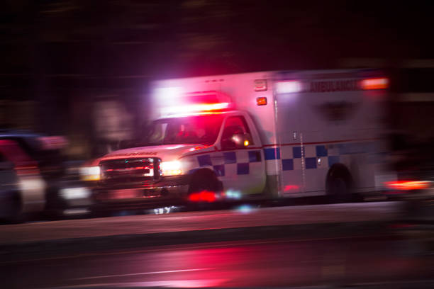 Ambulance An ambulance responds to an emergency call. ambulance stock pictures, royalty-free photos & images