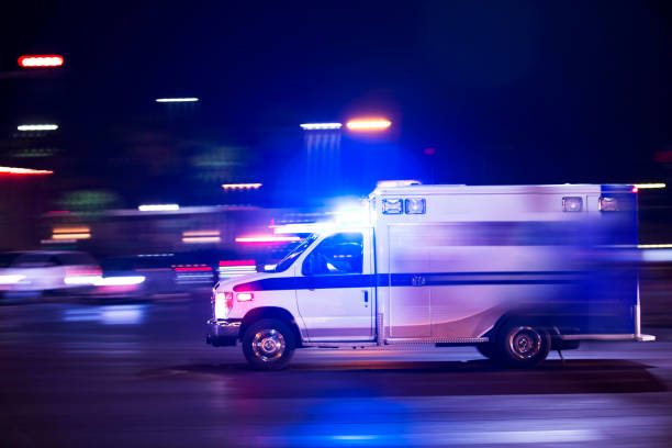 Ambulance An ambulance responds to the scene of an emergency. ambulance stock pictures, royalty-free photos & images