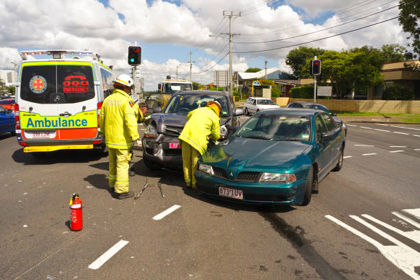Ambulance, Rescue and crashed cars at a vehicle accident stock photo