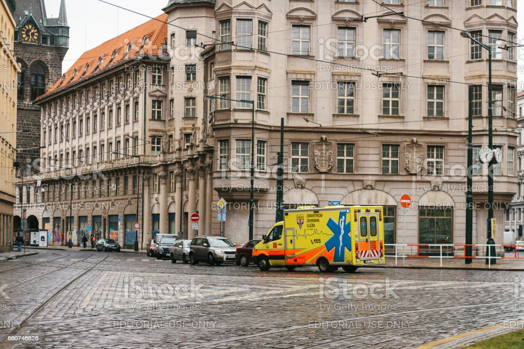 Ambulance rides to the patient along the street in Prague. Europe. Emergency first aid. stock photo