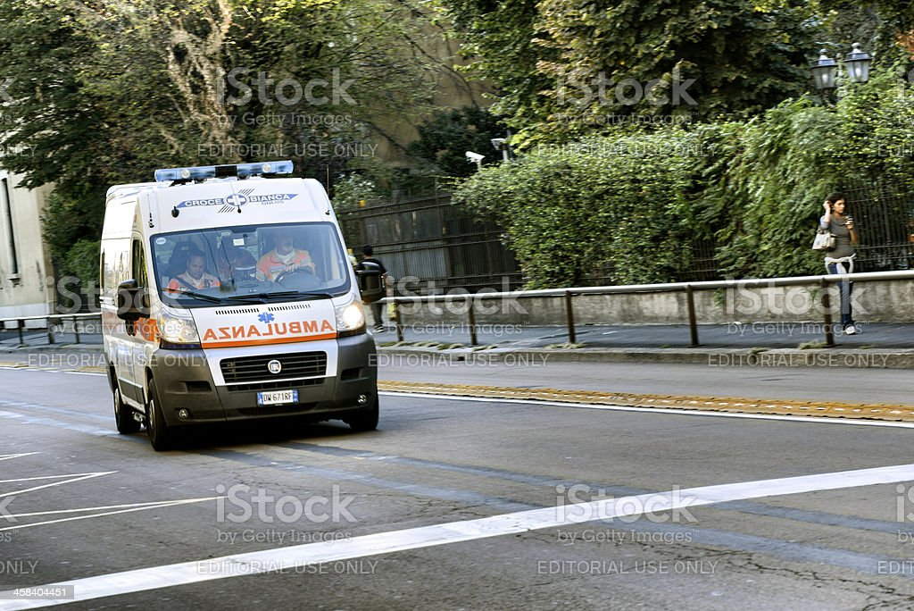 Ambulance running fast in Milan city centre street stock photo