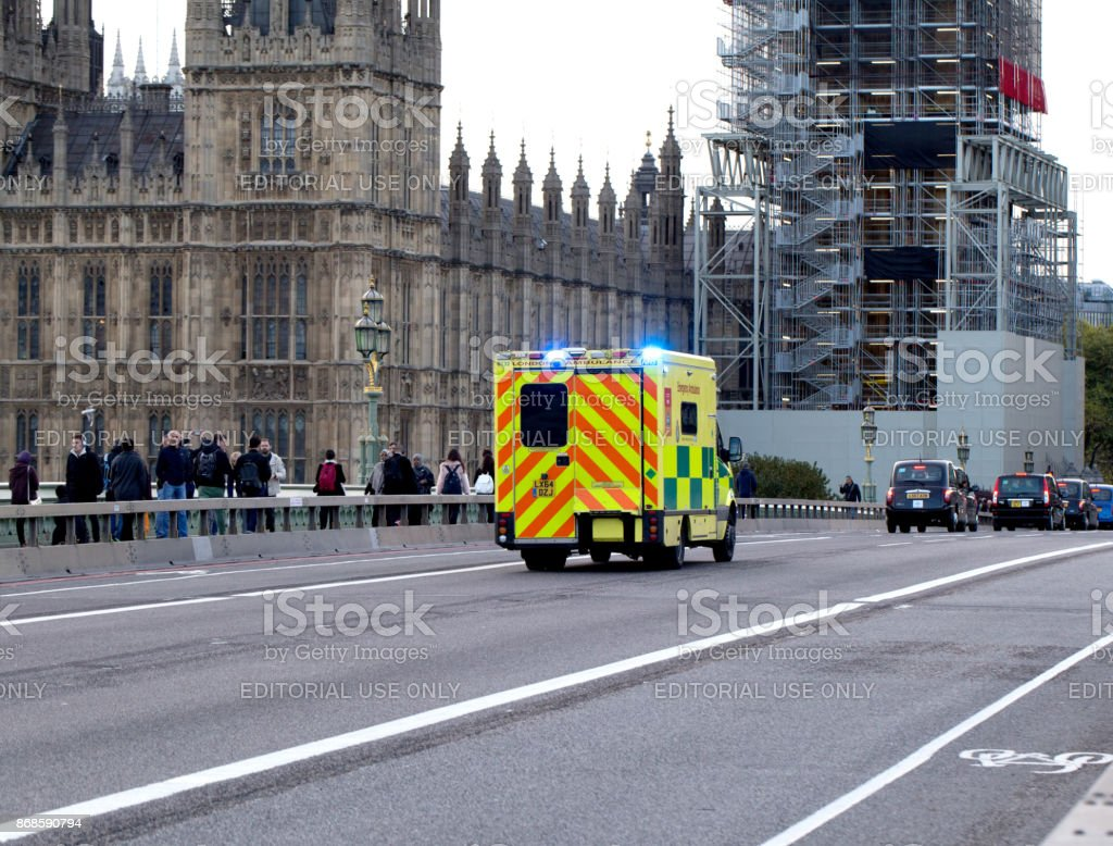 Ambulance rushing across Westminster Bridge, London on the way to a medical emergency stock photo