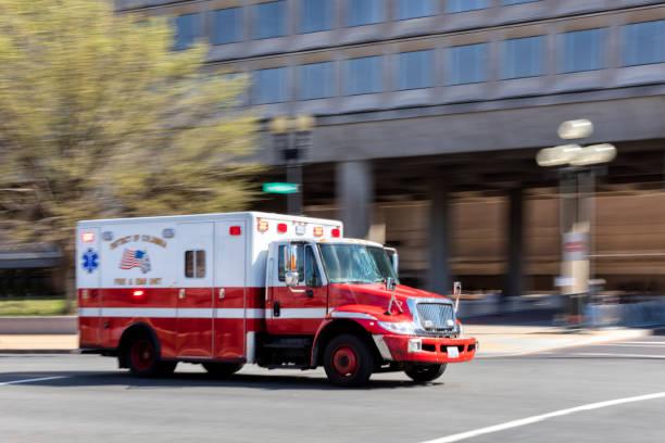 Ambulance Speeding Along City Street in Washington, Blurred Motion, District of Columbia stock photo