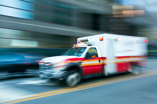 ambulance speeding in new york, blurred motion - ambulance stock photos and pictures