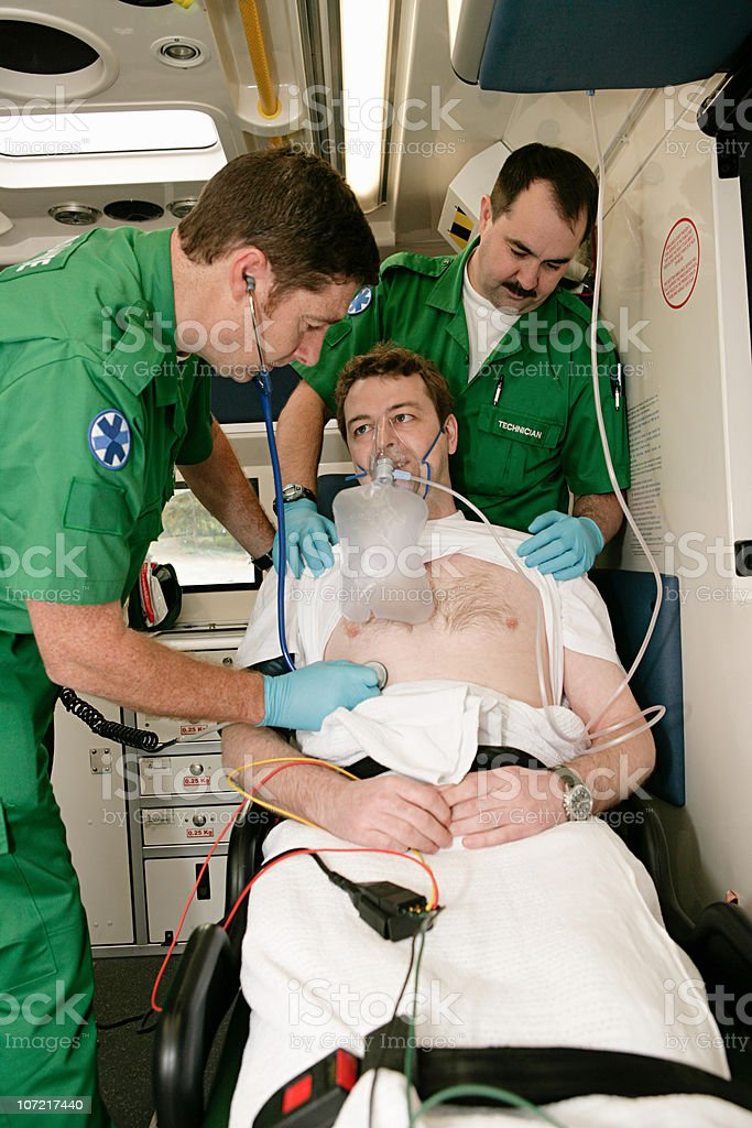 Ambulance technicians caring for patient stock photo