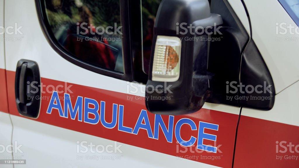 Ambulance transport closeup, emergency medical services, professional...