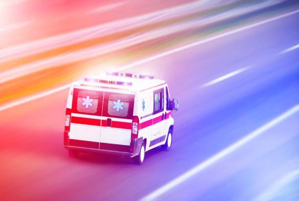 Ambulance van on highway, emergency stock photo