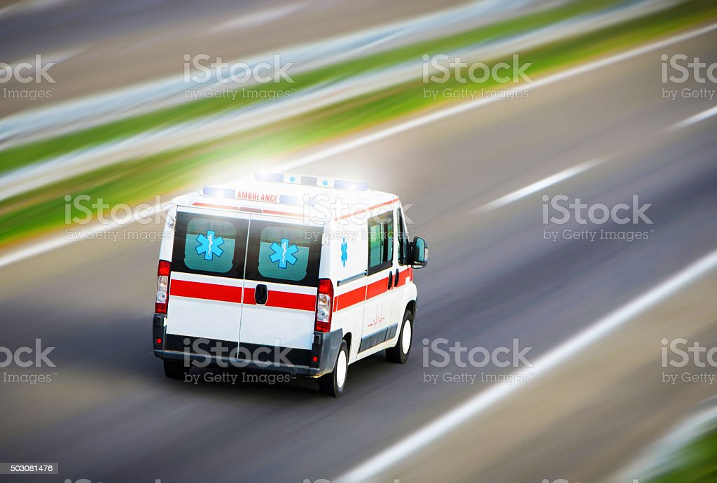 Ambulance van on highway stock photo