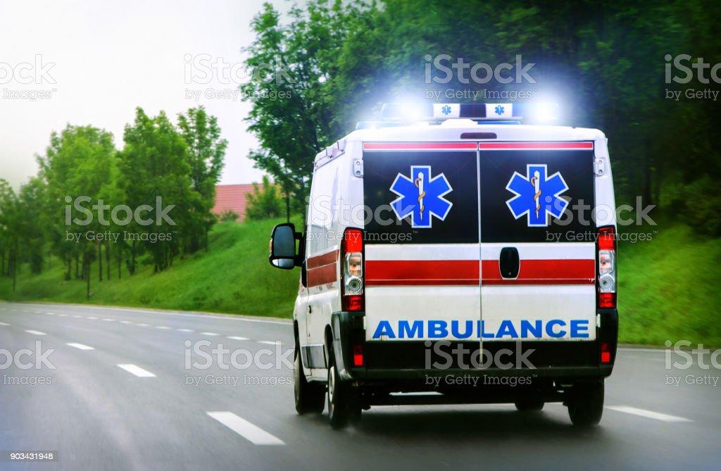 Ambulance van on highway stock photo