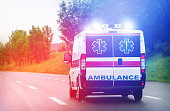 istock Ambulance van on highway with flashing lights 911803146