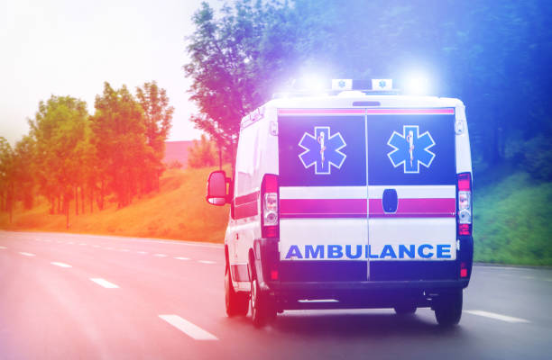 Ambulance van on highway with flashing lights stock photo