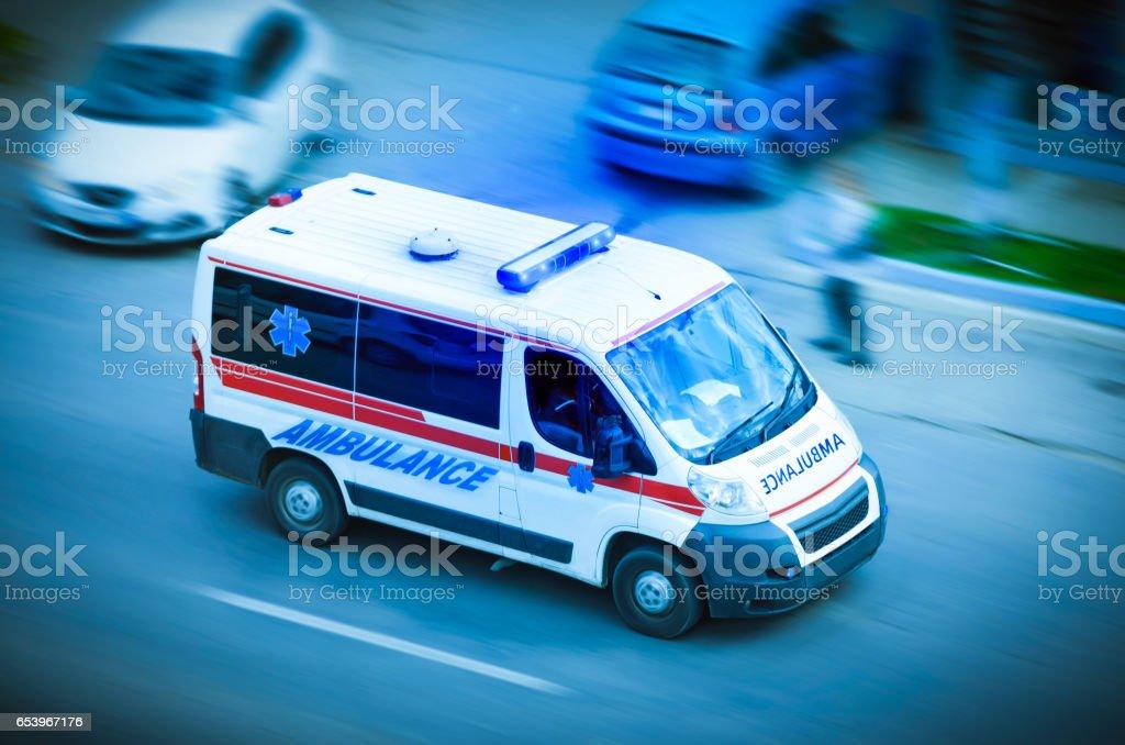 Ambulance van with flashing lights stock photo