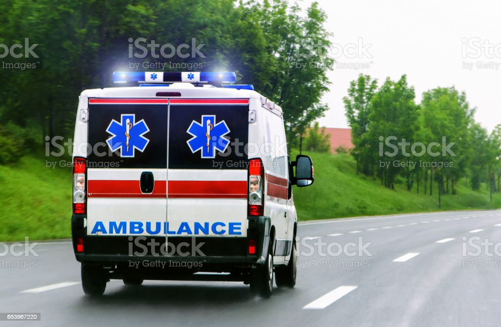 Ambulance van with flashing lights stock photo
