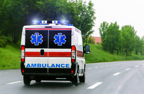 ambulance van with flashing lights - ambulance stock photos and pictures