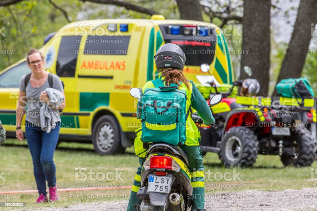 Ambulance vehicles and personnel outdoors. stock photo