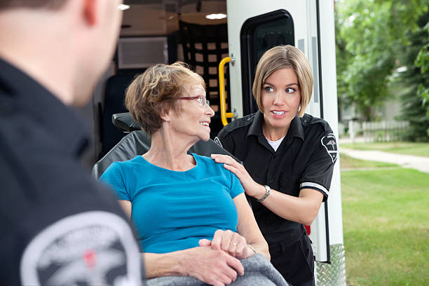 Ambulance Worker with Patient stock photo