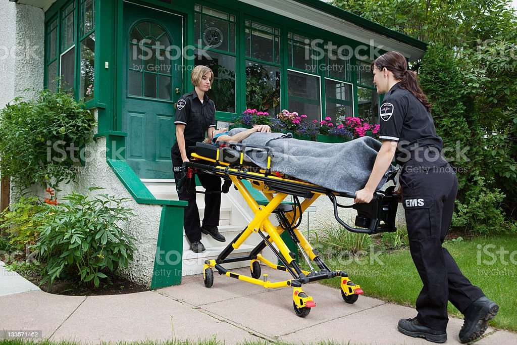 Ambulance Workers with Senior Woman royalty-free stock photo