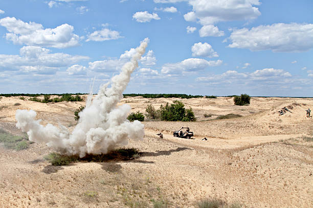 Ambush Large explosion near the car with soldiers in the desert ambush stock pictures, royalty-free photos & images