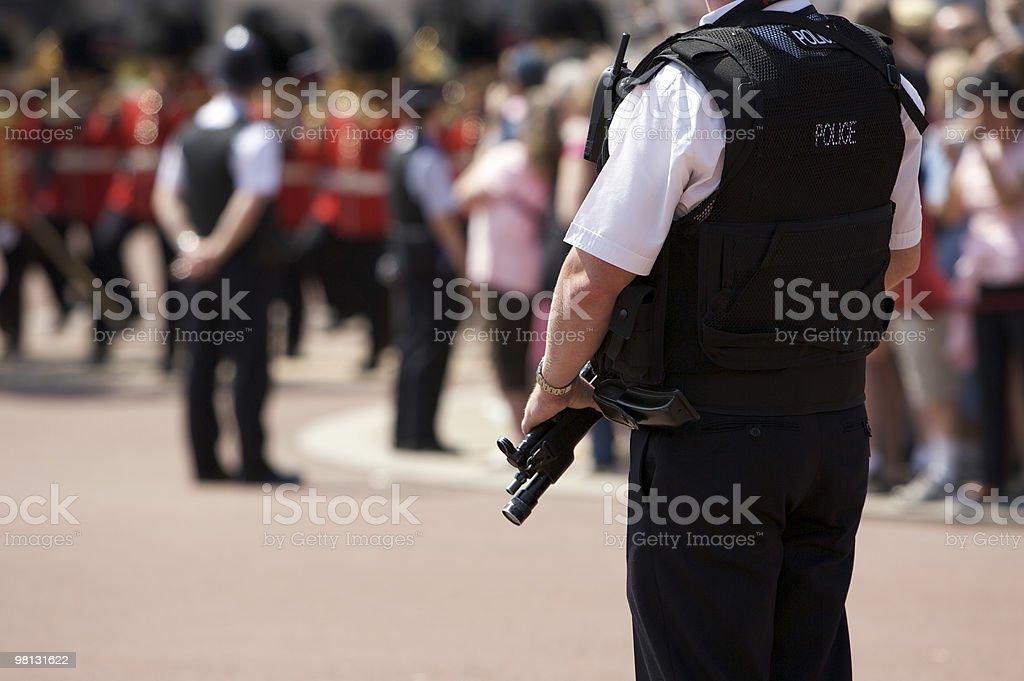 Amed Police Officer outside Buckingham Palace royalty-free stock photo