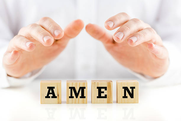 Amen Male hands making protective gesture over wooden cubes carrying Amen sign. Amen stock pictures, royalty-free photos & images