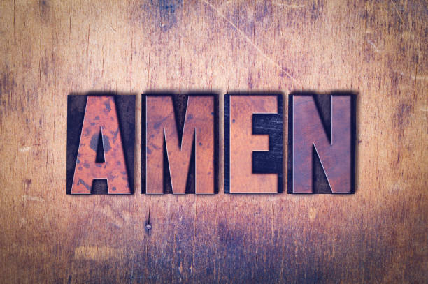 Amen Theme Letterpress Word on Wood Background The word Amen concept and theme written in vintage wooden letterpress type on a grunge background. Amen stock pictures, royalty-free photos & images