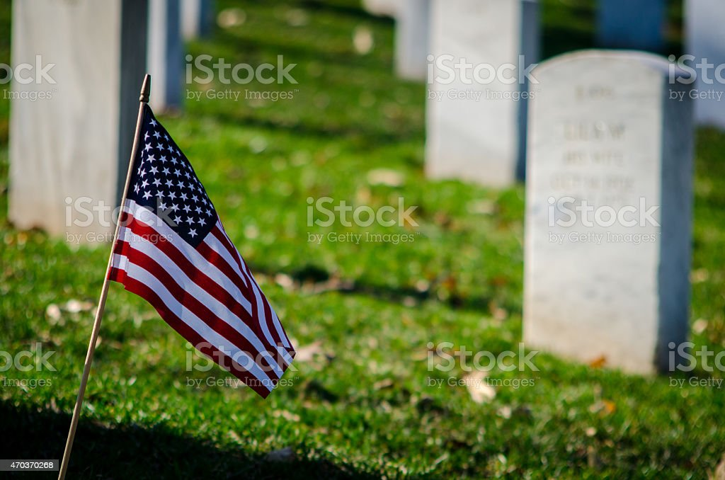 Amercan flag in a cemetery stock photo