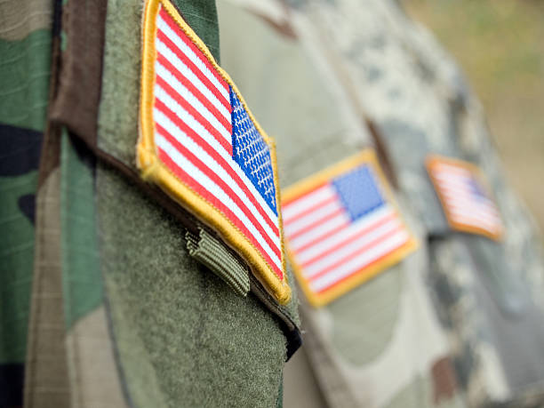 America flag on badges of soldiers' sleeves stock photo