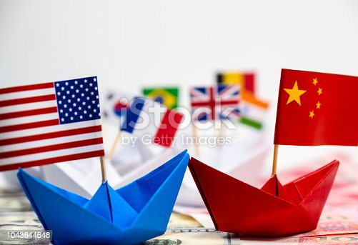 US America flag on blue ship and China flag on red ship and multi color flag with white background of war trade which they counteract by increase import and export tax barrier and effect world economy