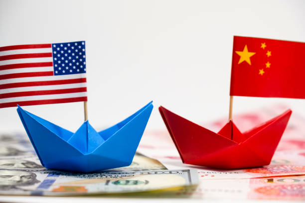 US America flag on blue ship and China flag on red ship and multi color flag with white background of war trade US America flag on blue ship and China flag on red ship and multi color flag with white background of war trade which they counteract by increase import and export tax barrier and effect world economy diplomacy stock pictures, royalty-free photos & images