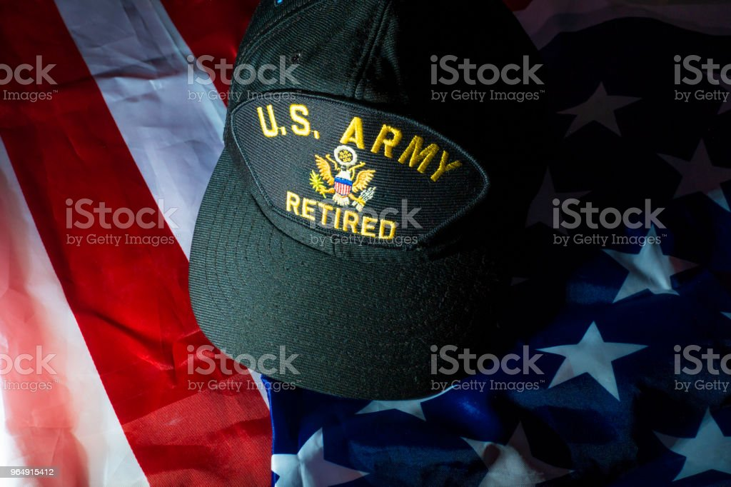 America memorial 4th July day background with US Army retired cap on flag. royalty-free stock photo