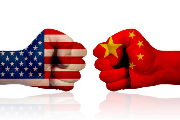 America vs China A fist with the American flag and a fist with the Chinese flag facing each other economic reform stock pictures, royalty-free photos & images