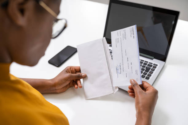 American African Holding Paycheck stock photo