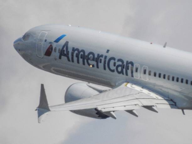 American Airline's 737 Max 8 Taking Off stock photo