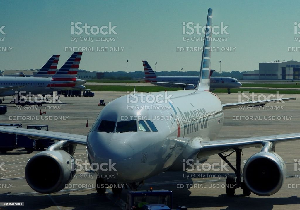American Airlines aircraft loading, arriving and departing stock photo