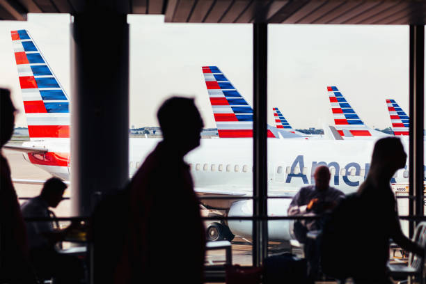 American Airlines fleet of airplanes with passengers at O'Hare Airport stock photo