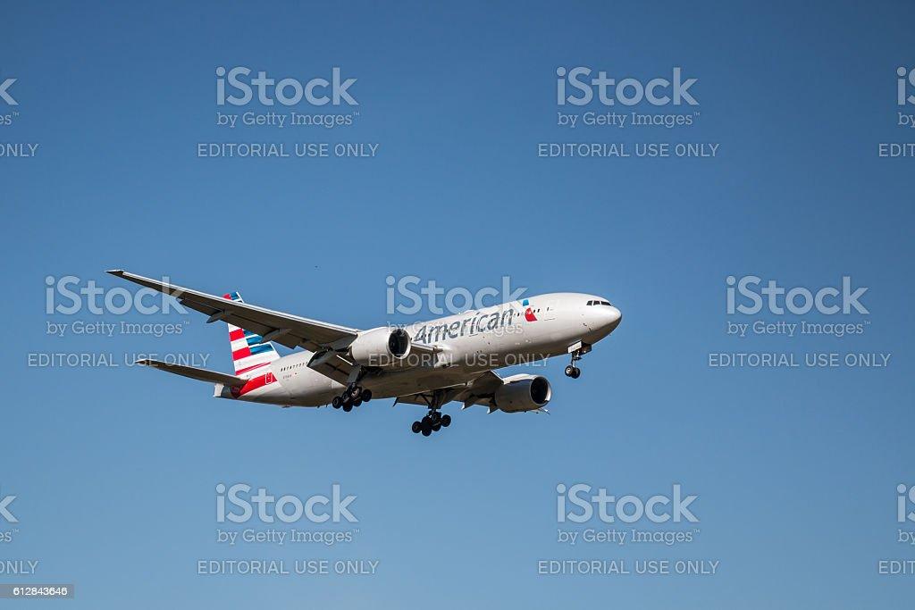 American Airlines plane landing stock photo