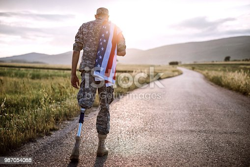 istock American Amputee Soldier On Road 987054088
