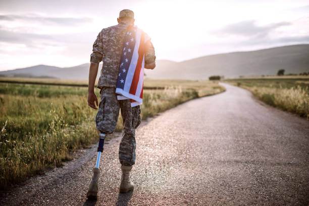 American Amputee Soldier On Road stock photo