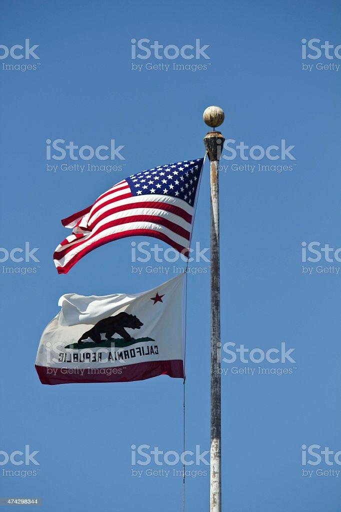 American and California flags waving stock photo