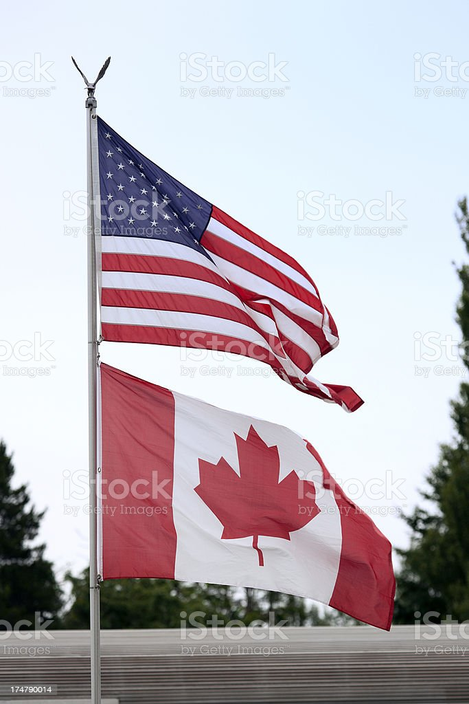 American and Canadian flags royalty-free stock photo