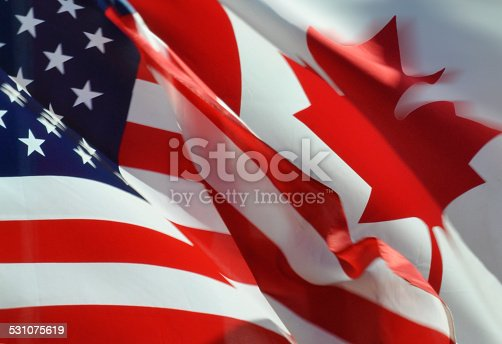 istock American and Canadian Flags 531075619