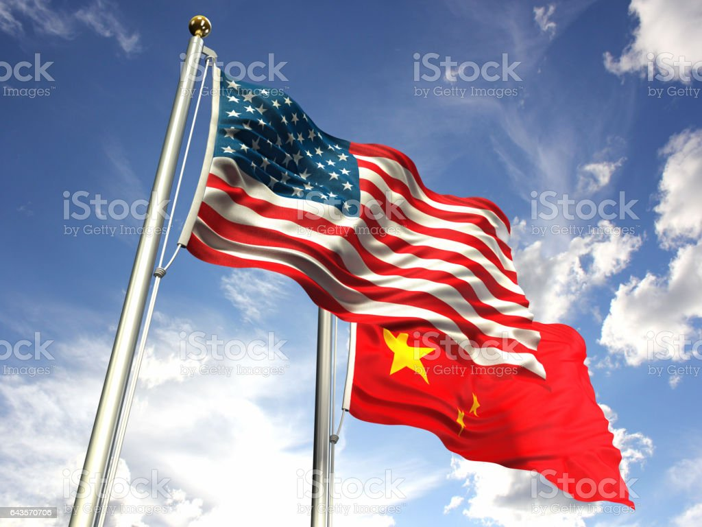 American and China flags waving against the sky stock photo