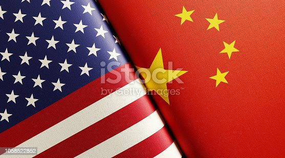 American and Chinese flag pair. Horizontal composition with copy space and selective focus.