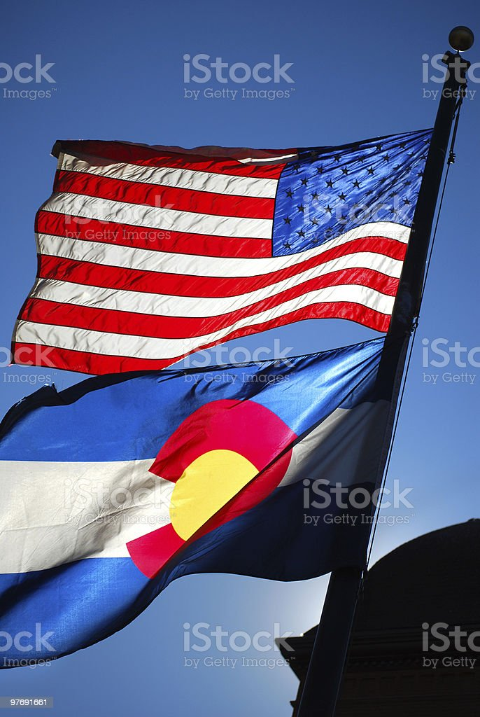 American and Colorado State Flag Waving in Sunlight stock photo