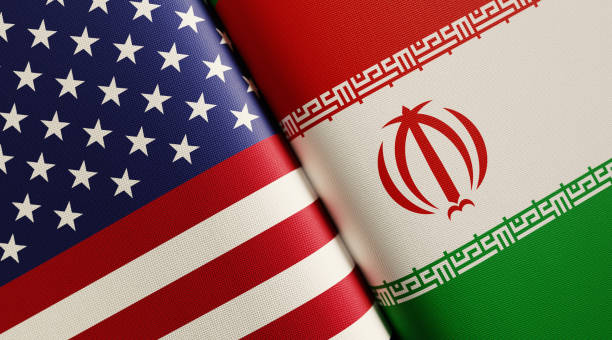 American And Iranian Flag Pair American and Iranian flag pair. Horizontal composition with copy space and selective focus. iran stock pictures, royalty-free photos & images
