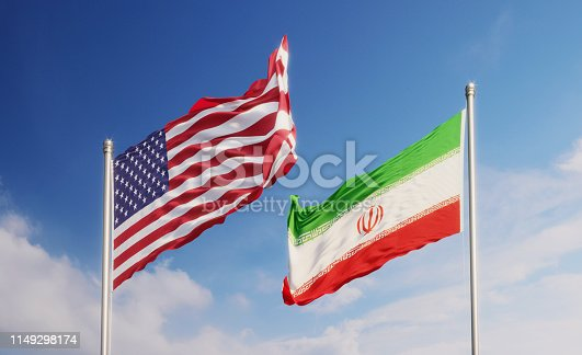 American and Iranian flags waving at opposite directions over blue sky. Horizontal composition with copy space.