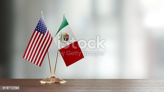 istock American And Mexican Flag Pair On A Desk Over Defocused Background 919712294
