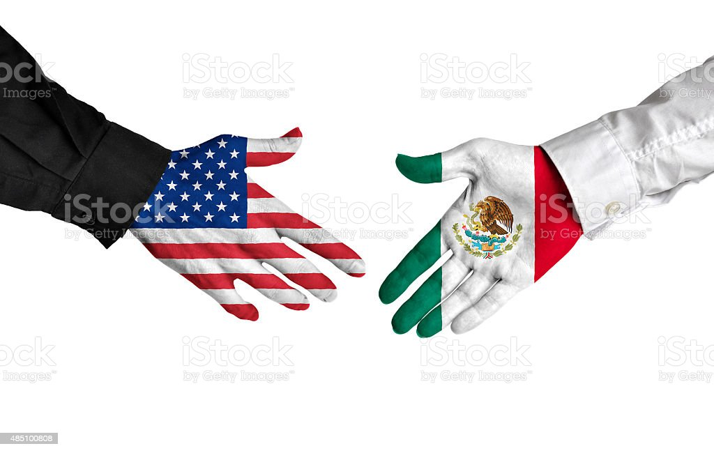American and Mexican leaders shaking hands on a deal agreement stock photo